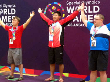 Nathan McClain, left, is pictured on the podium at the medal ceremony.